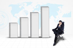 Businessman with chart on world map background Stock Image