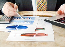 Businessman with charts. Stock Photos