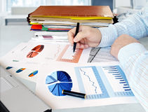 Businessman with Charts Stock Photo