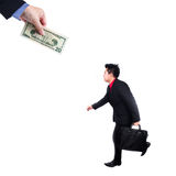 Businessman chase people with money metaphor Royalty Free Stock Photo