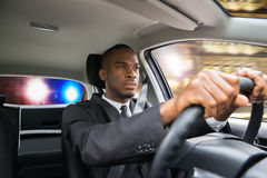Businessman Chased By Police While Driving Car Stock Photo