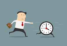 Businessman chasing a running clock Royalty Free Stock Photography