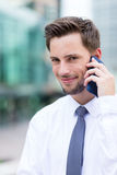 Businessman chat on mobile phone at outdoor Royalty Free Stock Images
