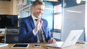 Businessman chatting on computer in the office. High quality royalty free stock photo