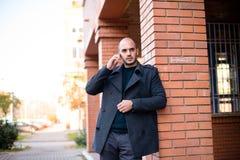 Businessman chatting on smartphone stock photo