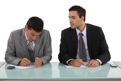 Businessman cheating in exam Stock Images