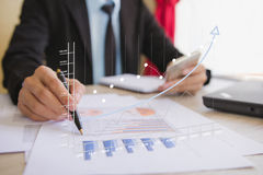 Businessman check business profits. With on project at office desk in office. Concept investor and finance. Concept business and financial Stock Images