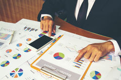Businessman check business report. Stock Photo