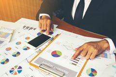 Businessman check business report. Royalty Free Stock Photos