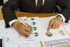 Businessman check business report. Royalty Free Stock Photography
