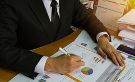 Businessman check business report. Stock Images