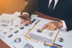 Businessman check business report. Stock Photos