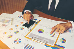 Businessman check business report. Royalty Free Stock Photo