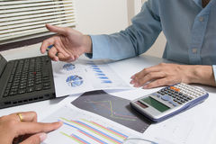Businessman check seriously analyzes a finance report investor colleagues discussing new plan financial graph data. bank managers. Task. Concept business and Royalty Free Stock Photos