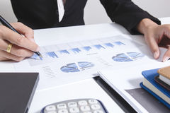 Businessman check seriously analyzes a finance report investor colleagues discussing new plan financial graph data. bank managers. Task. Concept business and Stock Photo