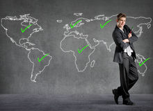 Businessman checked places on a world map Royalty Free Stock Images