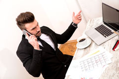 Businessman checking appointments in the calendar and talking by Stock Image