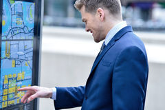 Businessman checking a bus timetable Stock Photo