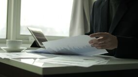 Businessman checking business document in the office stock video