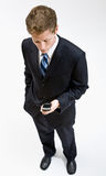 Businessman checking cell phone Stock Photography
