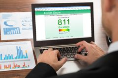 Businessman checking credit score. Close-up Of A Businessman Checking Credit Score Online On Laptop Stock Image