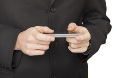 Businessman checking emails on the phone Royalty Free Stock Images
