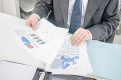 Businessman checking a file with financial graphs Royalty Free Stock Photo
