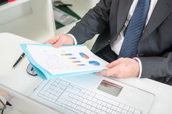 Businessman checking financial graphs Stock Photos