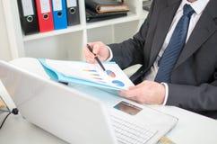 Businessman checking financial graphs Royalty Free Stock Image