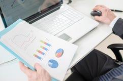 Businessman checking financial graphs Royalty Free Stock Photos