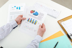 Businessman checking financial graphs Stock Image