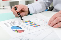 Businessman checking financial graphs Stock Images