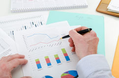 Businessman checking financial graphs Stock Photography