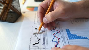 Businessman checking financial report and charts in the office at the workplace. stock video