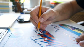 Businessman checking financial report and charts in the office at the workplace. stock footage