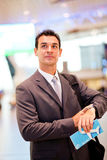 Businessman checking flight time Royalty Free Stock Photo