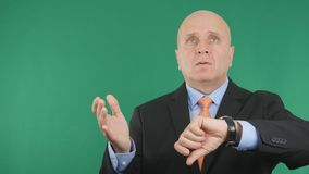 Businessman Checking Hand Watch Waiting a Late Meeting and Gesturing Nervous stock photography