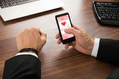 Businessman checking heart rate Royalty Free Stock Photo