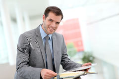 Businessman checking his appointments Stock Images