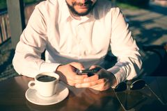 Businessman checking his smartphone Stock Photo