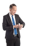 Businessman checking his watch Royalty Free Stock Photo