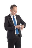 Businessman checking his watch Stock Photography