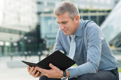 Businessman Checking The Mail Outdoor Stock Photography