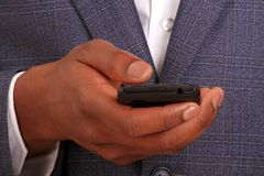 Businessman checking the mobile Royalty Free Stock Photography