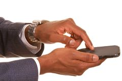 Businessman checking the mobile Stock Images