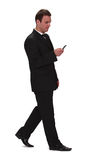 Businessman checking the mobile phone Stock Photo