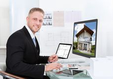Businessman checking a property portfolio online Royalty Free Stock Photos