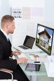 Businessman checking a property portfolio online Stock Image