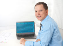 Businessman checking stock diagram in office Royalty Free Stock Photography