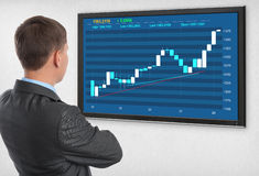 Businessman checking stock market Stock Photo